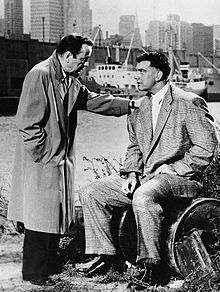 Bogart with his hand on the shoulder of a seated Mike Lane