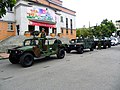 Humvees and V-150 Commando in ROC MP Headquarters.jpg