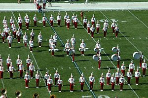 "Iowa State University Cyclone Marching Band - The drumline and brass instrumentalists forming the ""S"" for State during a pregame show"