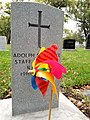 I just liked the look of this colourful pinwheel against the grey headstone. Taken in Elmwood Cemetery in Winnipeg, Manitoba, Canada. (43942868264).jpg