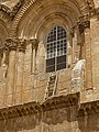 Immovable ladder on ledge over entrance to Church of the Holy Sepulchre.jpg