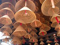 Incense coils hanging from the ceiling of an East Asian temple