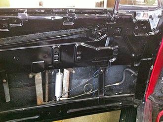 Power window - Inside drivers door showing hydraulic cylinder for power window