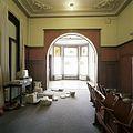 Interieur, overzicht van de rechter achterkamer met lambrisering en stucplafond, richting erker - Tilburg - 20388633 - RCE.jpg