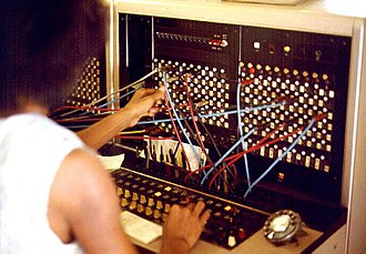 Telephone exchange - A telephone operator manually connecting calls with cord pairs at a telephone switchboard.