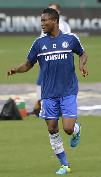 John Obi Mikel - Mikel warming up prior to a game against Roma in August 2013.