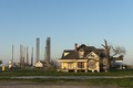 Juxtaposition of residential and industrial scenes in the tiny Gulf Coast settlement of Sabine Pass, Texas LCCN2014630850.tif