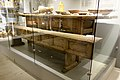 Karmsund folkemuseum (Regional Museum) Haugesund Norway 2020-06-10 Langbord 1600-t Langbenk dekketøy bestikk foldekniver tallerkner treboller treskjeer ølkjenge (Matrettar 1700-talet Måltid) Wooden 16c table bench plates 18c knives.jpg