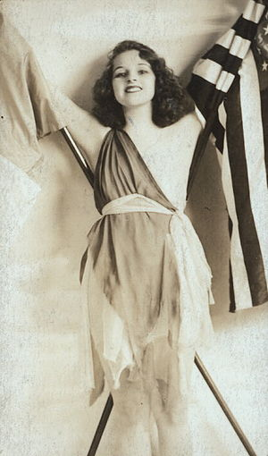"Kay Laurell - Laurell as ""The Spirit of the Allies"" in the Ziegfeld Follies of 1918. The photo was later edited to cover her exposed breast."