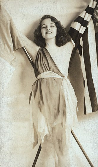 """Kay Laurell - Laurell as """"The Spirit of the Allies"""" in the Ziegfeld Follies of 1918. The photo was later edited to cover her exposed breast."""