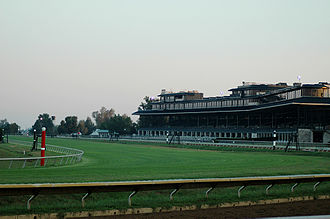 Keeneland - A view of Keeneland's grandstand at dawn, taken from the last turn leading into the home stretch