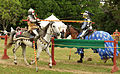 Knights jousting, lances breaking on shields.jpg