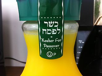 Kashrut - The label on a bottle of orange juice certifying that it is kosher for Passover.