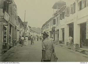 Kuching - A street scene of Kuching town shortly after the surrender of Japan, image taken on 12 September 1945.