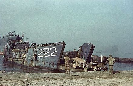 U.S. Navy tank landing craft offloads a U.S. Army jeep at Salerno. LCT-222 on beach with Jeep 1943.jpg