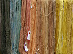 Skeins of wool colored with natural plant dyes.
