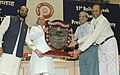 Lalu Prasad presenting the Outstanding Service Award to Railwaymen on the occasion of the 51st Railway Week, in New Delhi on April 10, 2006. The Minister of State for Railways, Shri Naranbhai J. Rathwa is also seen.jpg