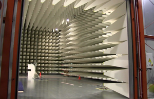 Radiation-absorbent material - A large drive-in RF anechoic test chamber. Note the orange caution cones for size reference.