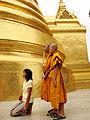 Lascar Buddhist monks and woman at Phra Sri Rattana Chedi (4509760518).jpg
