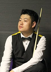 Photograph of a sitting Liang Wenbo