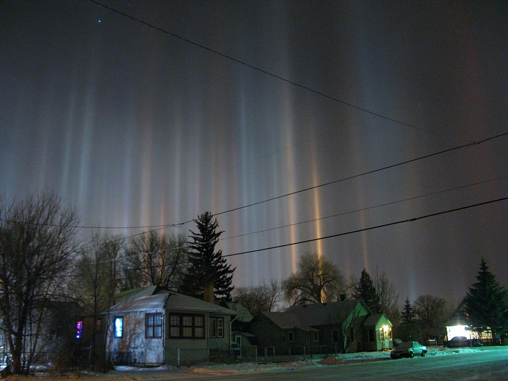 Light pillars over Laramie Wyoming in winter night