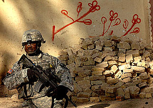 Operation Phantom Strike - Staff Sgt. Donnie Dixon pulls security while conducting an Operation Lightning Hammer patrol in Mukeisha, Iraq, 14 Aug 2007.