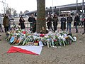 Local residents have brought flowers to commemorate the victims of the tram attack on March 18, 2019 at the 24 Oktoberplein, Utrecht.jpg