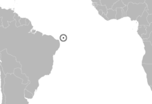 Map of the southern Atlantic Ocean with southwestern Africa and northeastern South America, with an island off northeastern Brazil highlighted.