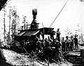 Loggers and donkey engine in National Lumber and Manufacturing Company camp 7, probably in Cedarville, ca 1923 (KINSEY 1110).jpeg