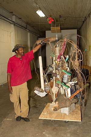 Lonnie Holley - Lonnie Holley with his sculpture 'Drilling for Greedy', 2011