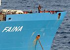 Somali pirates standing guard aboard the Faina.