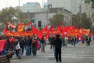 Anti-revisionism - Supporters of the Chilean Communist Party (Proletarian Action), an anti-revisionist party, march during the May Day 2007 manifestations in Santiago, Chile, carrying a banner with the portraits of Marx, Engels, Lenin and Stalin.