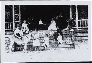 Maria Jolas - Maria McDonald Jolas, photographed as a child in Louisville, Kentucky, ca. 1910. She is seated in the middle of the staircase.