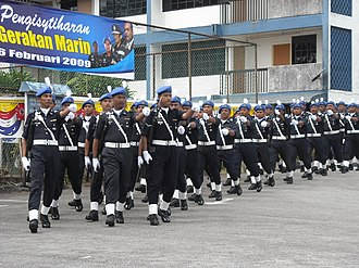 Marine Operations Force - The marine police march during the declaration of PGM on 6 February 2009. The officers are wearing skyblue berets, the new berets of the unit and carried the M16 rifles