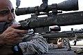 Marine snipers site in on targets (4809341473).jpg