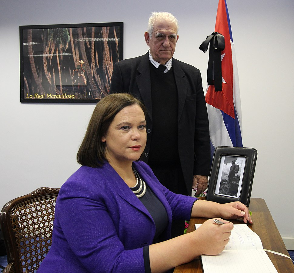 Mary Lou McDonald with Dr Hermes Herrera Hernández signing the book of condolence to Fidel Castro at the Cuban Embassy in Dublin (30489680553)
