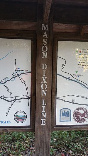 Mason–Dixon line - Mason–Dixon line where the Torrey C. Brown Rail Trail becomes the York County Heritage Trail near New Freedom, Pennsylvania