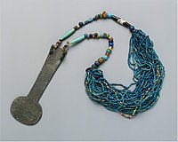 Necklace made up of many strands of colorful stone beads