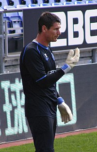 Mike Pollitt warming up, Wigan Athletic v Bolton Wanderers, 15 October 2011.jpg
