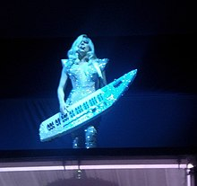 "Gaga performing ""Just Dance"" while playing a keytar."