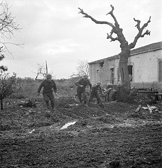 Moro River Campaign - Riflemen of the 48th Highlanders of Canada take cover during German counterattack north of San Leonardo, 10 December 1943.