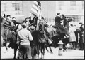 Mounted police clashing with strikers, one carrying an American flag, outside an electrical plant in Philadelphia, 1946 - NARA - 541924.tif