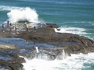 Rock fishing - Extreme rock fishing off Muriwai Beach, New Zealand