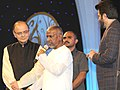 Music Maestro Ilayaraja speaking after receiving the centenary award at the inauguration of the 46th International Film Festival of India (IFFI-2015), in Panaji, Goa. The Union Minister for Finance.jpg