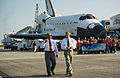 NASA administrators walk on the SLF runway following completion of last shuttle mission.jpg