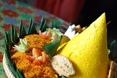 nasi kuning in its tumpeng form