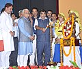 Nitin Gadkari lighting the lamp at the foundation stone laying ceremony for the Four-laning of Hisar-Dabwali National Highway, at Sirsa, Haryana. The Chief Minister of Haryana, Shri Manohar Lal Khattar is also seen.jpg