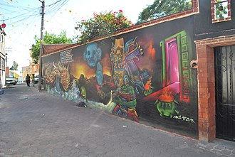 Pueblo Culhuacán - Graffiti mural by Nomadas Colectivo on 16 de Septiembre Street.