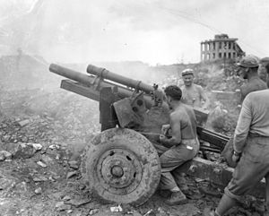 15th Marine Regiment (United States) - 15th Marine Regiment 105mm Howitzer crew in Naha, Okinawa.