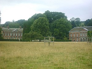 Okeover Hall - The east wing and ivy-clad church (left) and stable block (right)